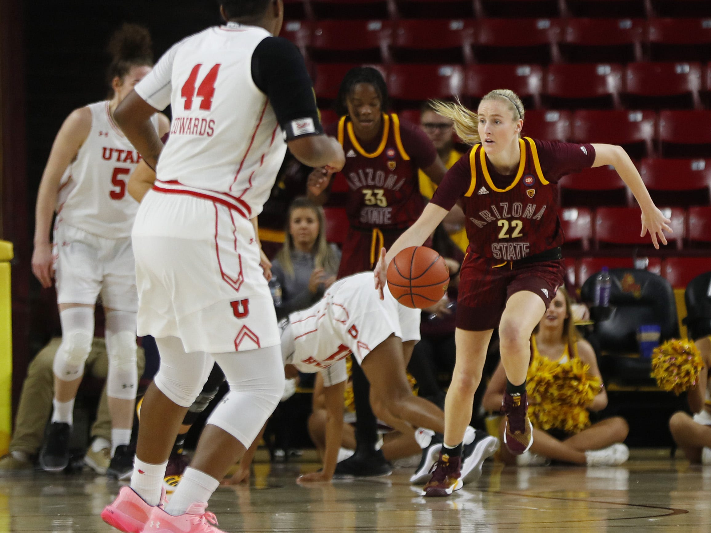 ASU's Courtney Ekmark (22) dribbles up court against Utah during the first half at Wells Fargo Arena in Tempe, Ariz. on February 17, 2019.