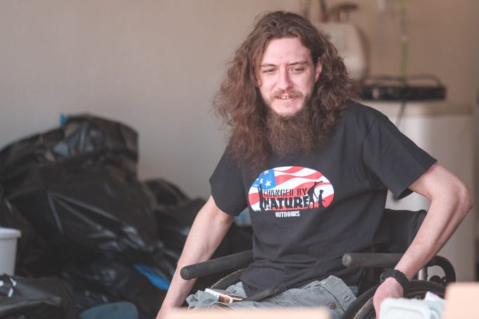 Army veteran Matt Zajac sits in his garage of his home in San Tan Valley, Arizona on Saturday, Feb. 16, 2019.
