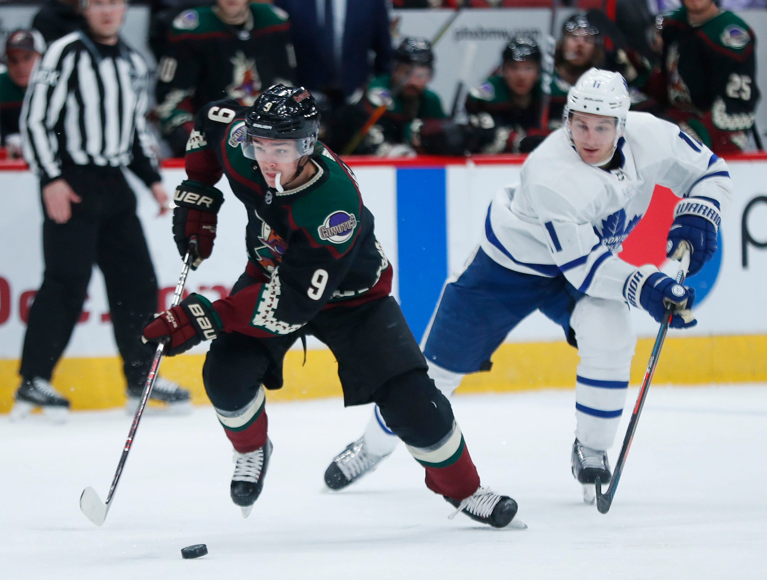 Coyotes' Clayton Keller (9) skates against Maple Leafs' Zach Hyman (11) during the second period at Gila River Arena in Glendale, Ariz. on February 16, 2019.