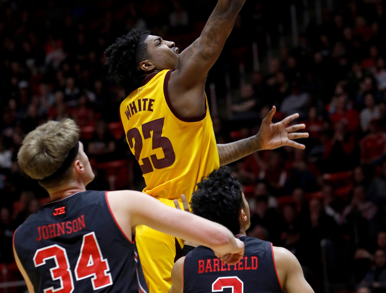 Arizona State's Romello White (23) shoots a layup as Utah's Jayce Johnson (34) and Sedrick Barefield (2) defend during the first half of an NCAA college basketball game Saturday, Feb. 16, 2019, in Salt Lake City. (AP Photo/Kim Raff)