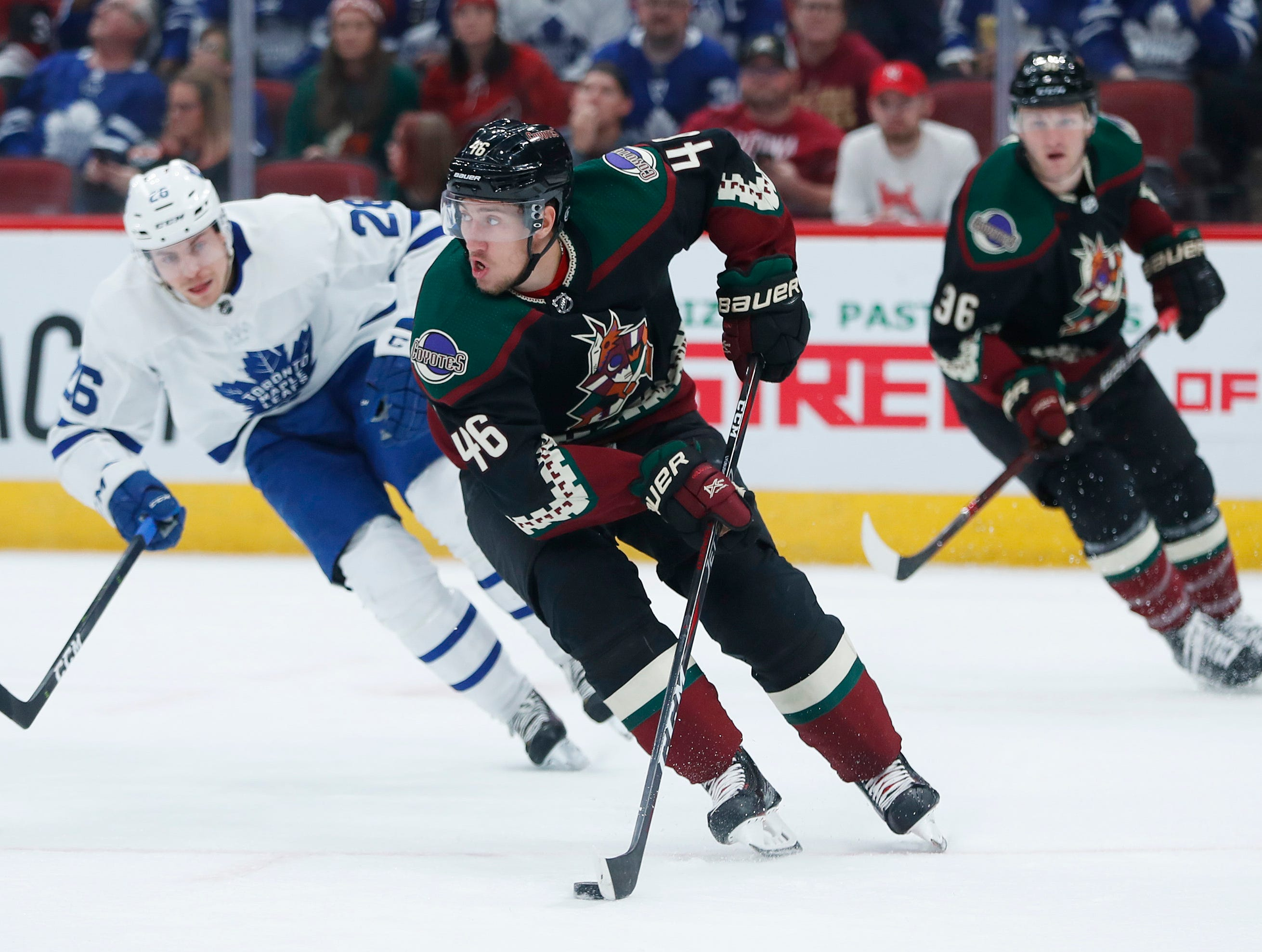 Coyotes' Ilya Lyubushkin (46) skates up the ice against Maple Leafs' Connor Brown (28) during the first period at Gila River Arena in Glendale, Ariz. on February 16, 2019.