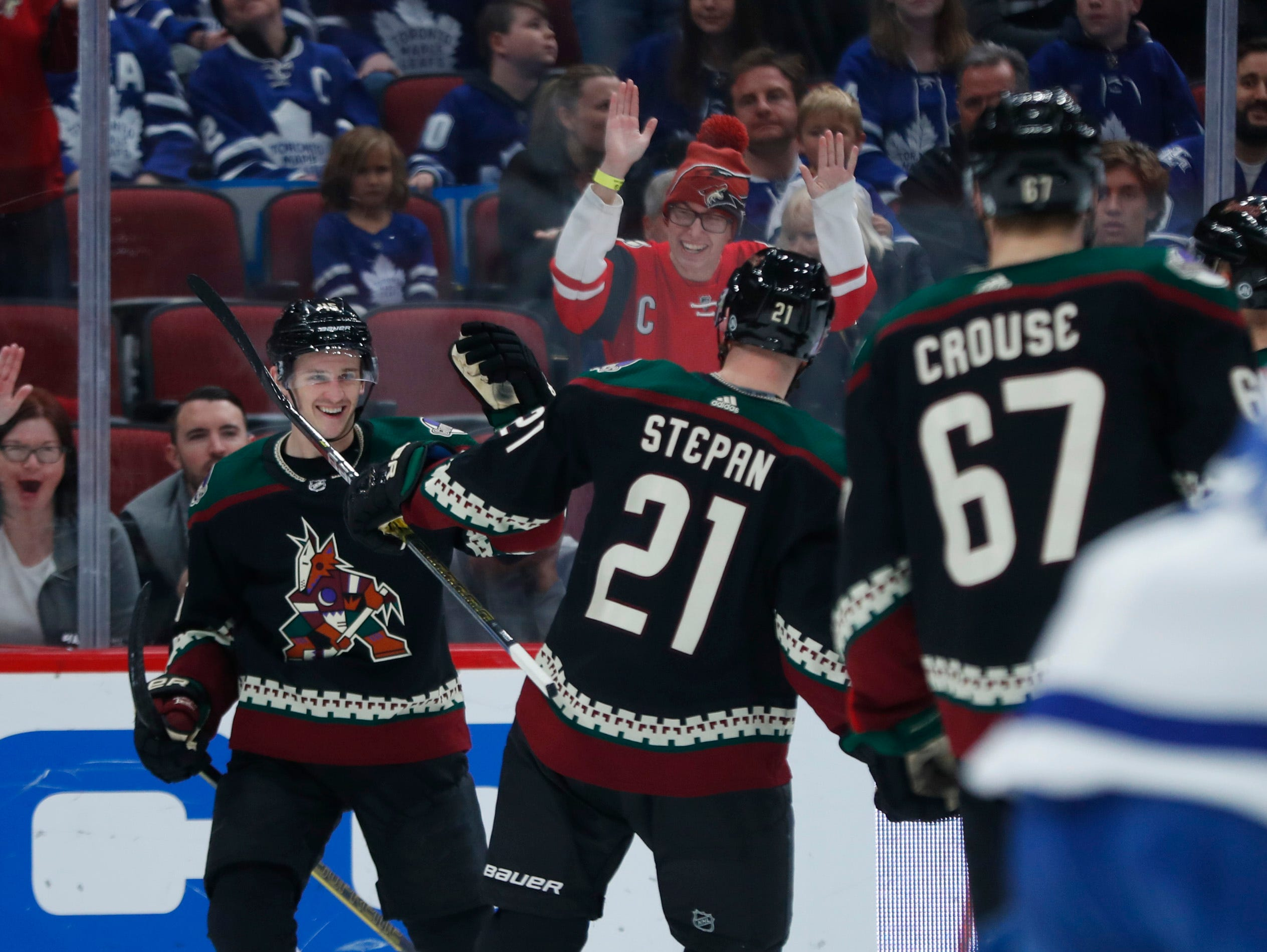 Coyotes' Josh Archibald (45) celebrates his goal with teammates Derek Stepan (21) and Lawson Crouse (67) during the second period at Gila River Arena in Glendale, Ariz. on February 16, 2019.