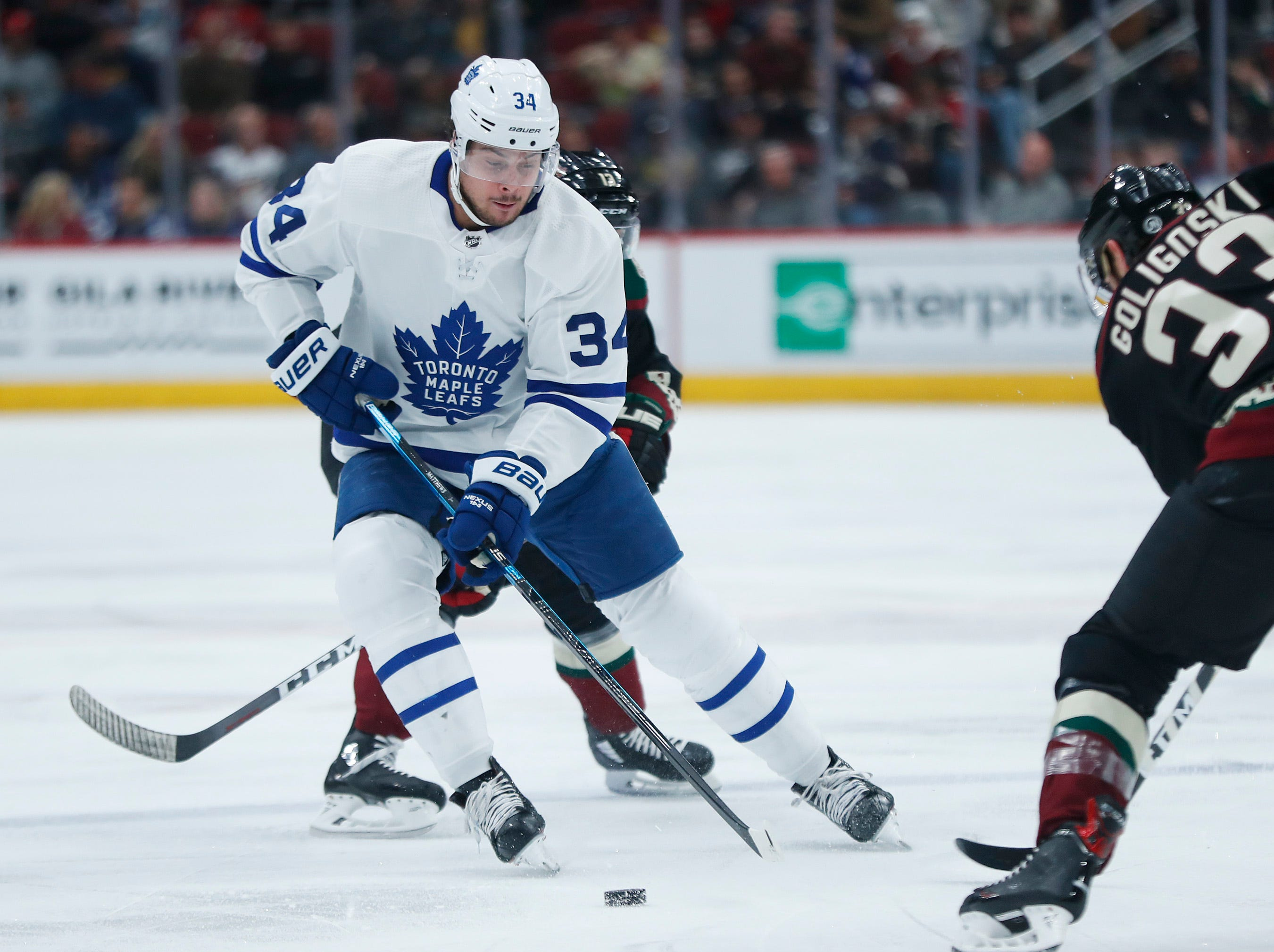 Maple Leafs' Auston Matthews (34) skates up against Coyotes' Alex Goligoski (33) during the first period at Gila River Arena in Glendale, Ariz. on February 16, 2019.