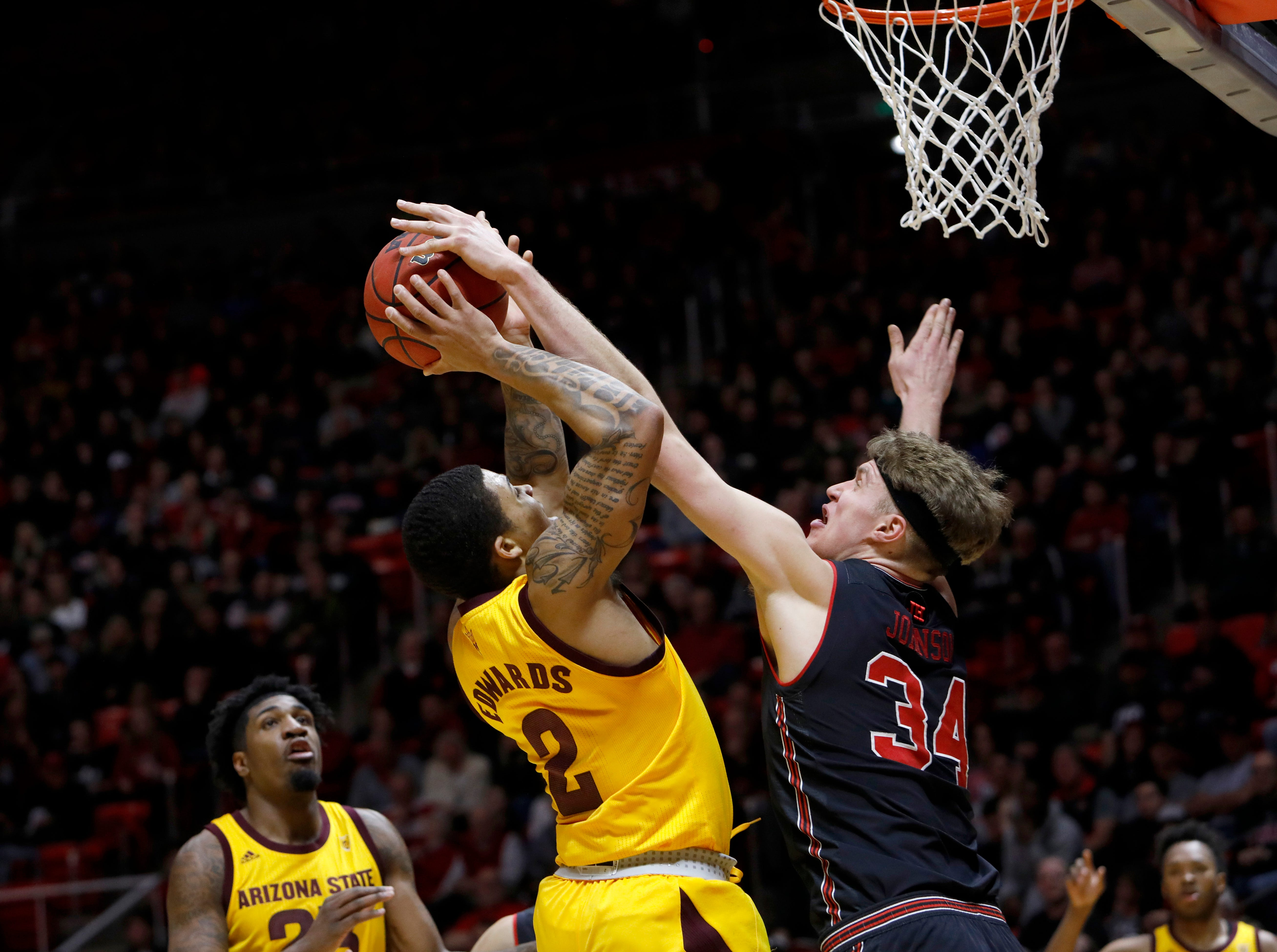 Arizona State's Rob Edwards (2) attempts a shot as Utah's Jayce Johnson (34) gets a hand on the ball during the first half of an NCAA college basketball game Saturday, Feb. 16, 2019, in Salt Lake City. (AP Photo/Kim Raff)