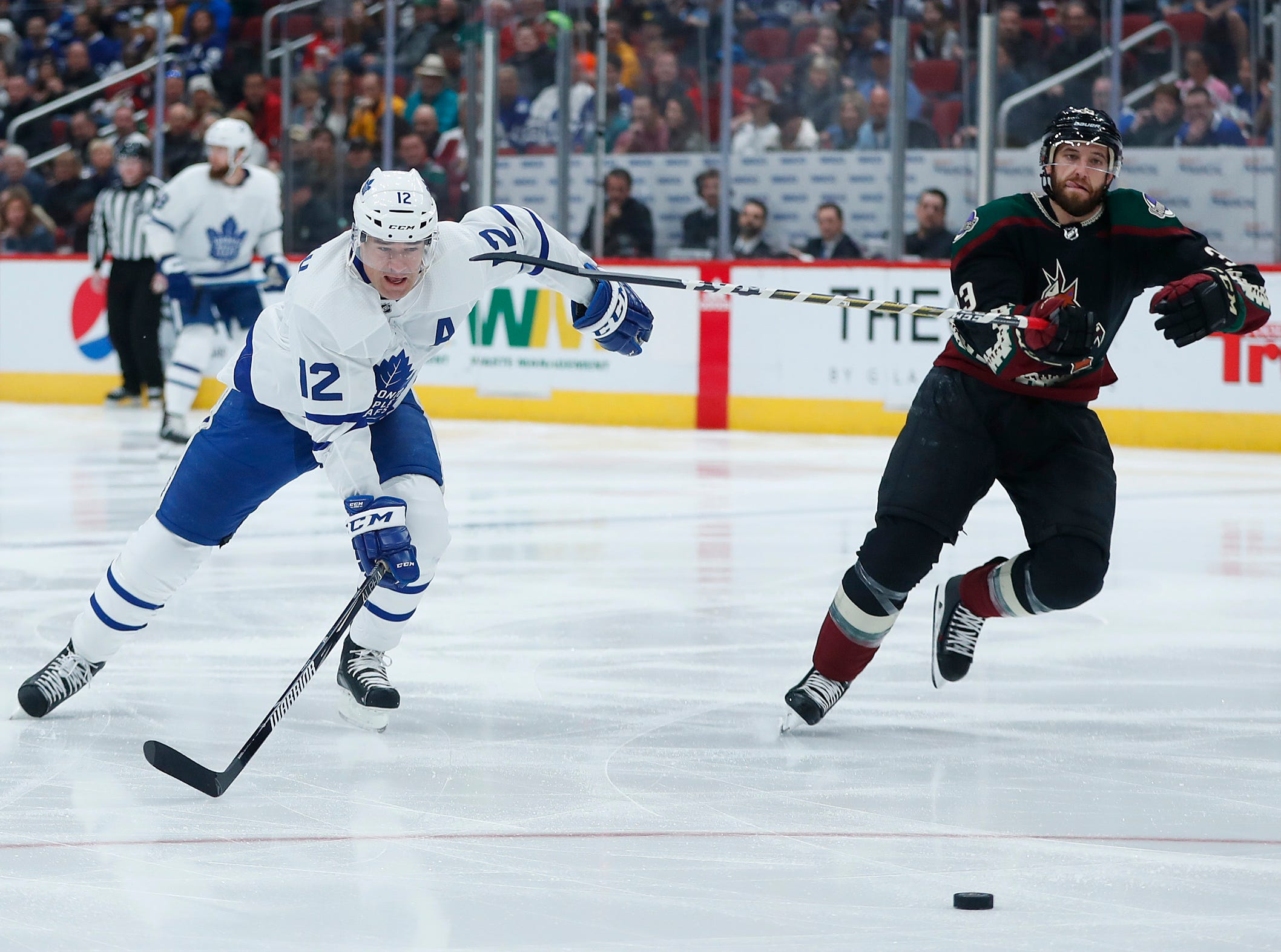Coyotes' Alex Goligoski (33) and Maple Leafs' Patrick Marleau (12) during the first period at Gila River Arena in Glendale, Ariz. on February 16, 2019.