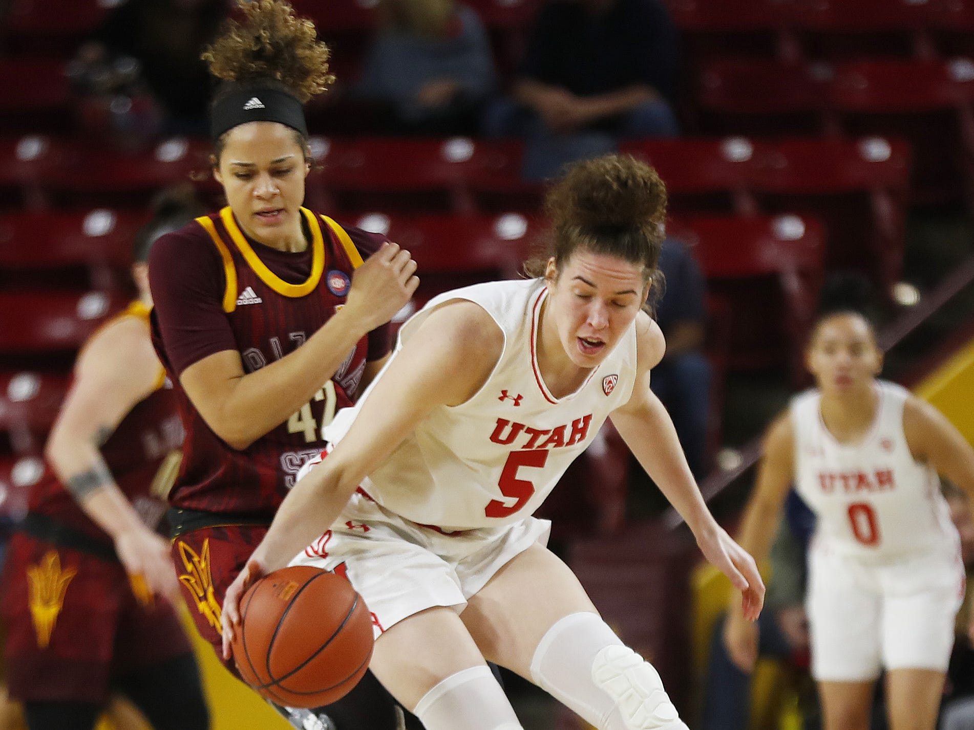 ASU's Kianna Ibis (42) puts pressure on Utah's Megan Huff (5) during the first half at Wells Fargo Arena in Tempe, Ariz. on February 17, 2019.