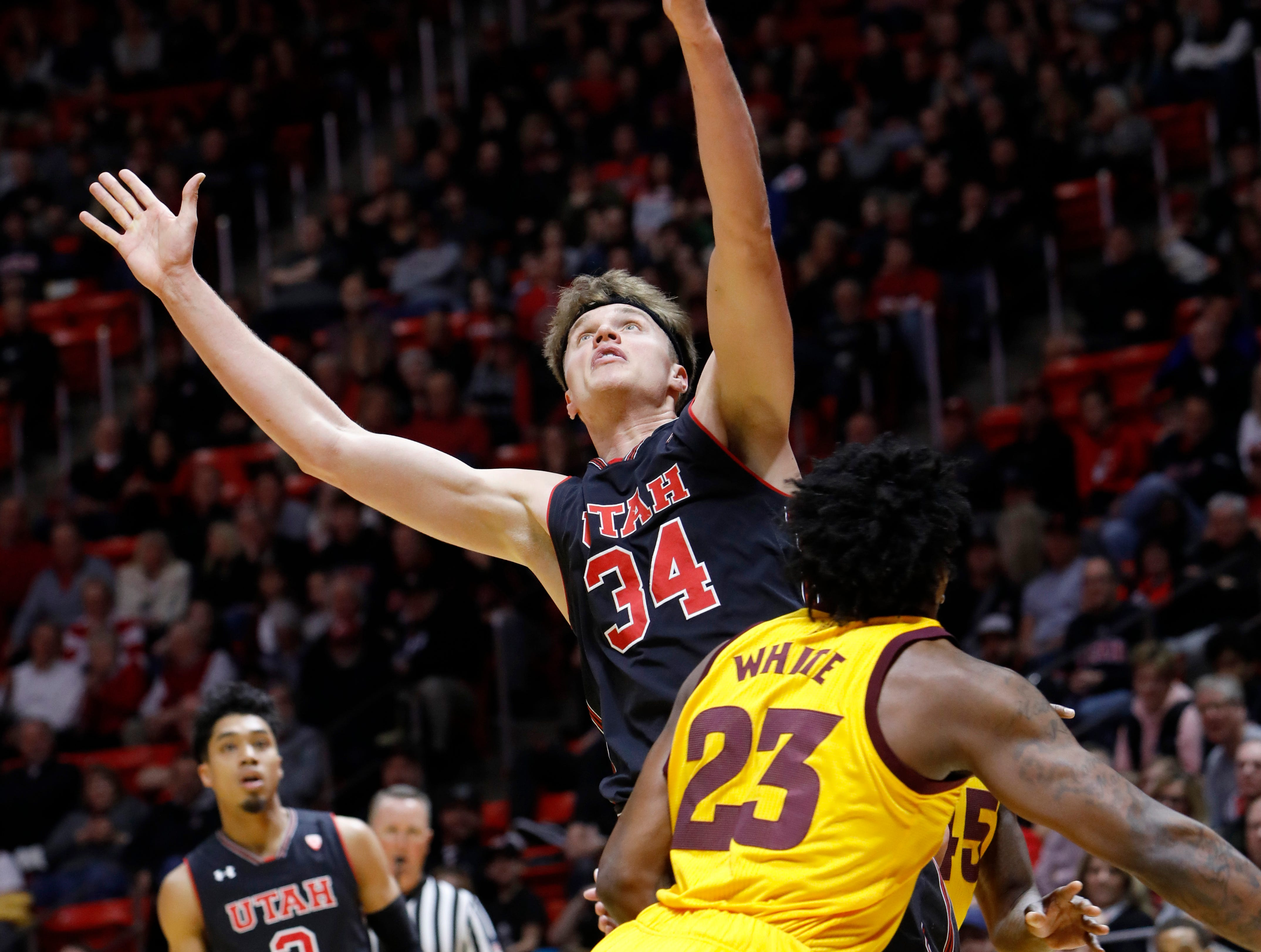 Utah's Jayce Johnson (34) reaches for a rebound next to Arizona State's Romello White (23) during the first half of an NCAA college basketball game Saturday, Feb. 16, 2019, in Salt Lake City. (AP Photo/Kim Raff)