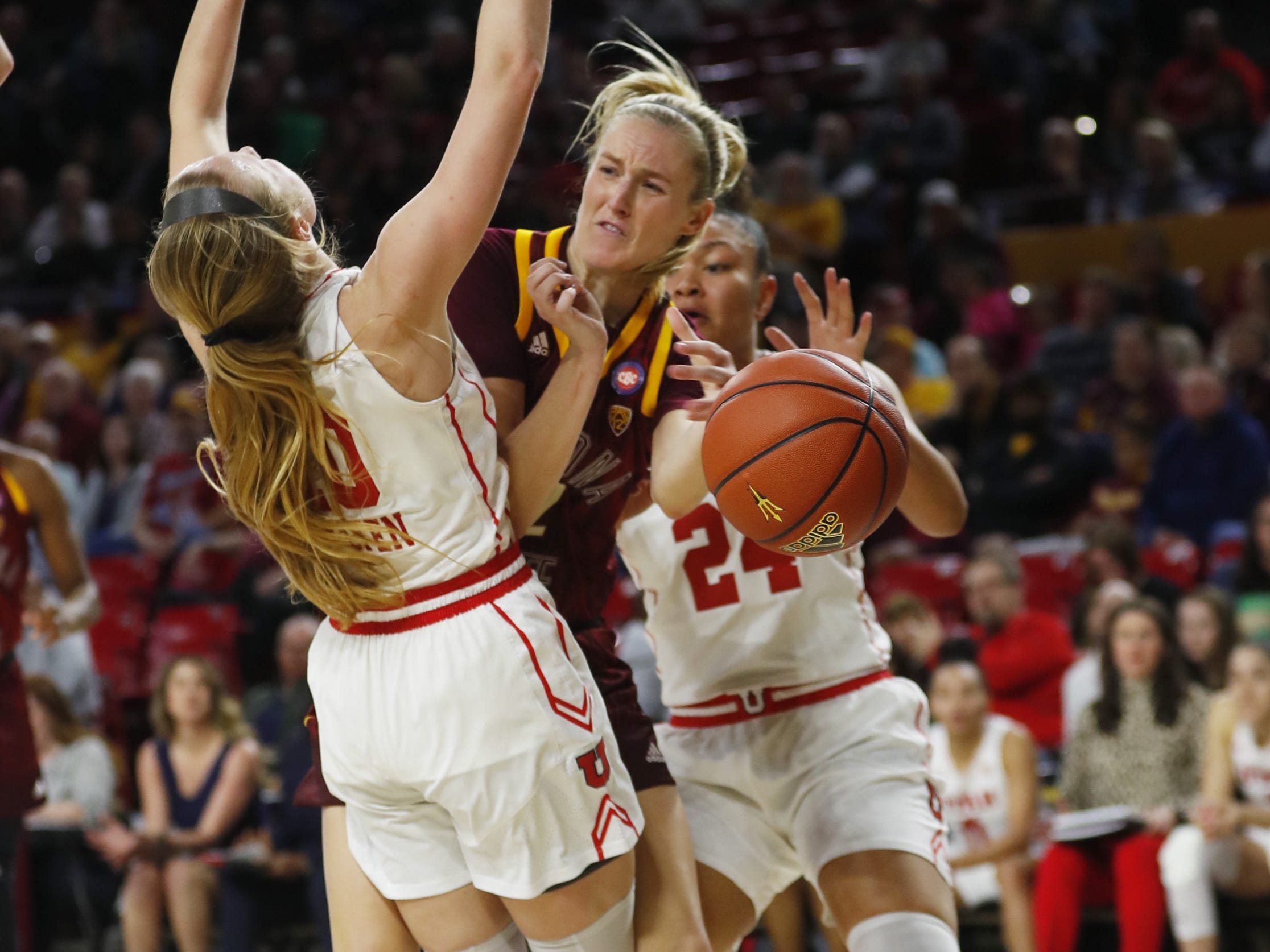 ASU's Courtney Ekmark (22) draws a blocking foul on Utah's Dru Gylten (10) during the first half at Wells Fargo Arena in Tempe, Ariz. on February 17, 2019.