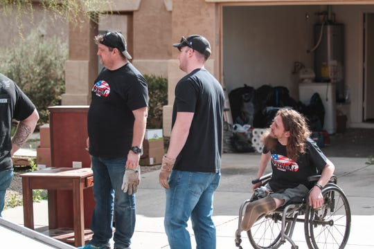 Members of Changed By Nature Outdoors help pack at Matt Zajac's home in San Tan Valley, Arizona on Saturday, Feb. 16, 2019.