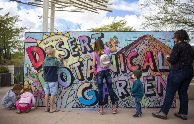 Kids color a mural in celebration of the the Desert Botanical Garden 80th Anniversary on Saturday, Feb. 26, 2019.