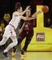 ASU's Kianna Ibis (42) knocks away a pass intended for Utah's Megan Huff (5) during the first half at Wells Fargo Arena in Tempe, Ariz. on February 17, 2019.