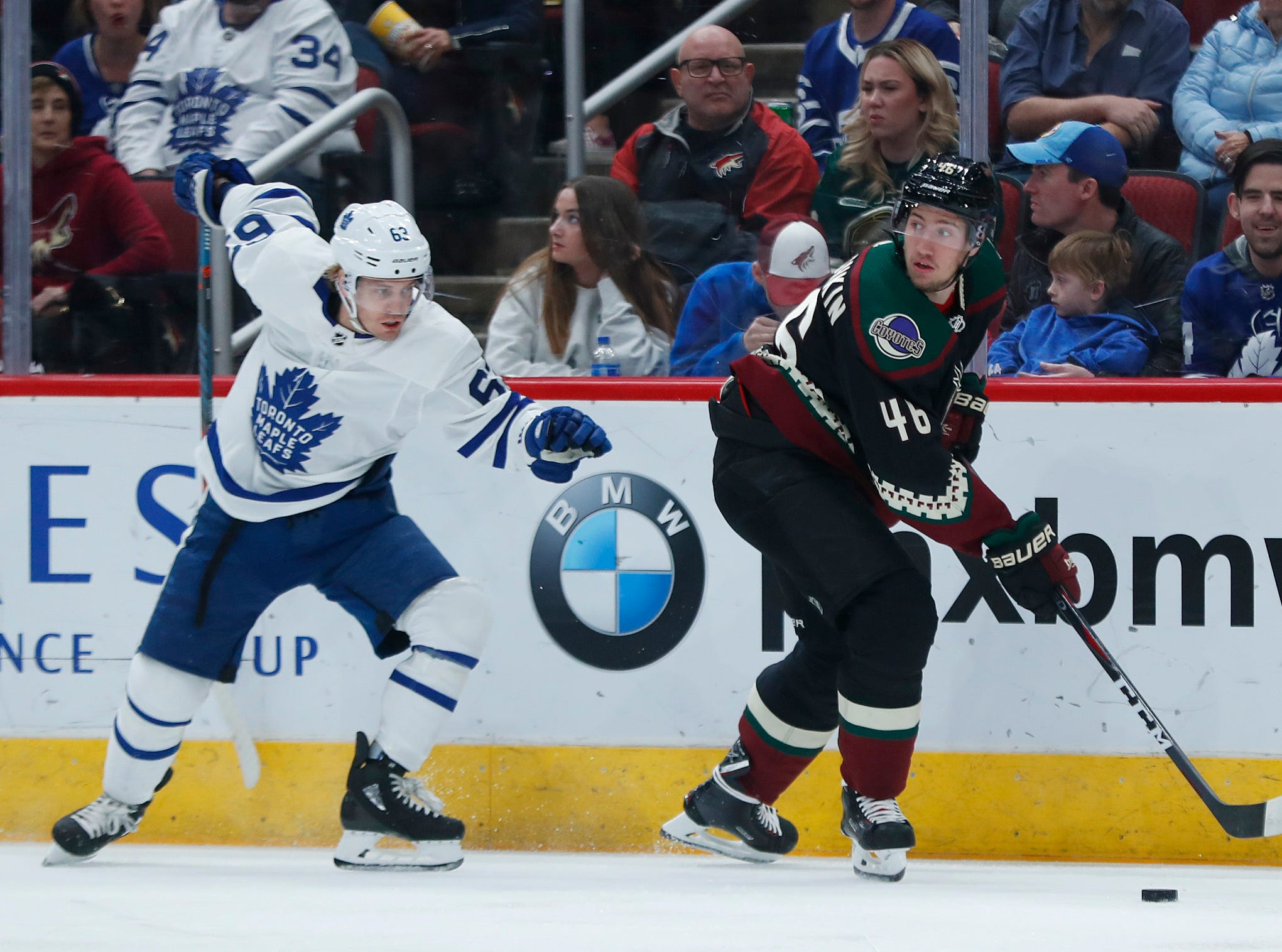 Coyotes' Ilya Lyubushkin (46) turns against the defense of Maple Leafs' Tyler Ennis (63) during the first period at Gila River Arena in Glendale, Ariz. on February 16, 2019.
