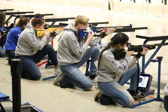 Cadets shoot in the kneeling portion of the air rifle regional competition, part the 2019 JROTC Service Championships at Camp Perry this past weekend.