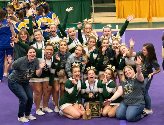 The Franklin D. Roosevelt cheer team celebrates after winning a third consecutive Section 9 championship on Saturday.