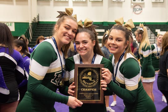 The Franklin D. Roosevelt cheerleading captains pose with their Section 9 championship plaque on Feb. 16. From left: Eden Palmer, MacKenzie Squire and Sierra Kowalski.