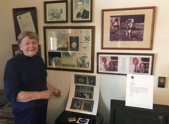 Margaret Gsell stands in front of her wall of NASA memorabilia on Thursday, Feb. 14, 2019, at her home in Menno Haven Retirement Community, Chambersburg.