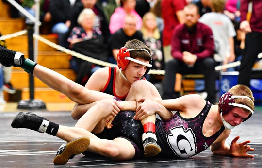 Dover's Mason Leiphart, left, and Gettysburg's Jacob Fetrow wrestle in the 106-pound weight class during PIAA District 3 Section IV action at South Western High School on Feb. 16, 2019. Both wrestlers are top sectional seeds this season. Leiphart enters sectional action with a 27-0 record. Dawn J. Sagert photo