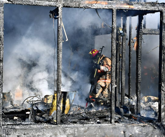 York Area United Fire and Rescue work a fire in the 500 block of Wynwood Road in Springettsbury Township, Saturday, Feb. 16, 2019. Dawn J. Sagert photo