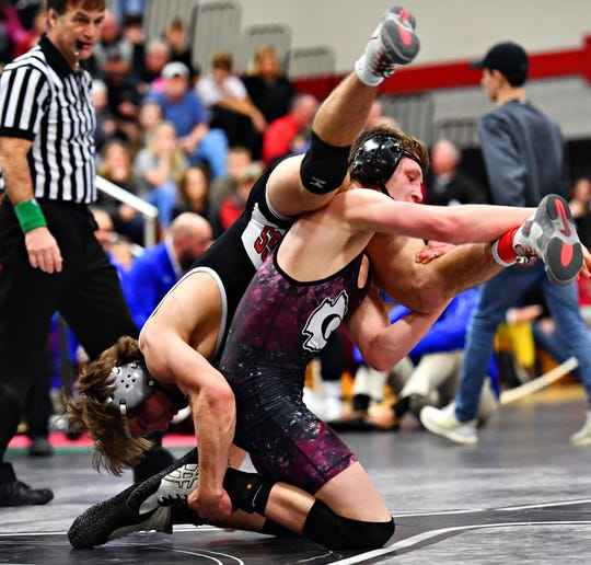South Western's Ethan Baney, left, and Gettysburg's Dylan Reinert, shown here wrestling in the District III tournament, are both wrestling the 160-pound PIAA tournament this weekend. Dawn J. Sagert photo