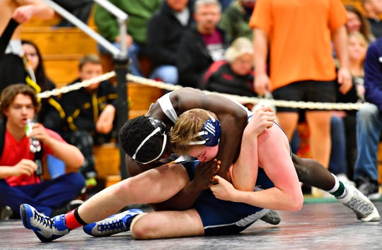 Dallastown's Jamal Brandon, back, and West York's Frank Veloce wrestle in the 220 pound weight class during the PIAA District III, Section IV Wrestling Tournament championship bout at South Western High School in Hanover, Saturday, Feb. 16, 2019. Dawn J. Sagert photo