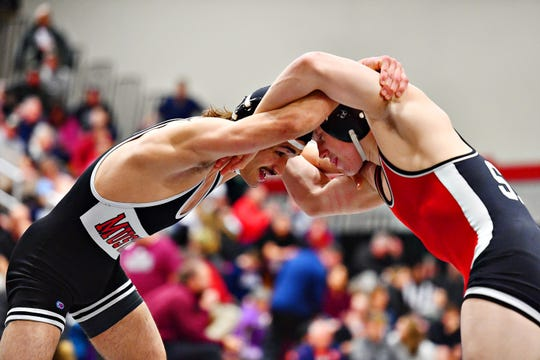 South Western's Calvin Sullivan, left, and Susquehannock's Colby Romjue wrestle in the 152 pound weight class during the PIAA District III, Section IV Wrestling Tournament championship bout at South Western High School in Hanover, Saturday, Feb. 16, 2019. Dawn J. Sagert photo