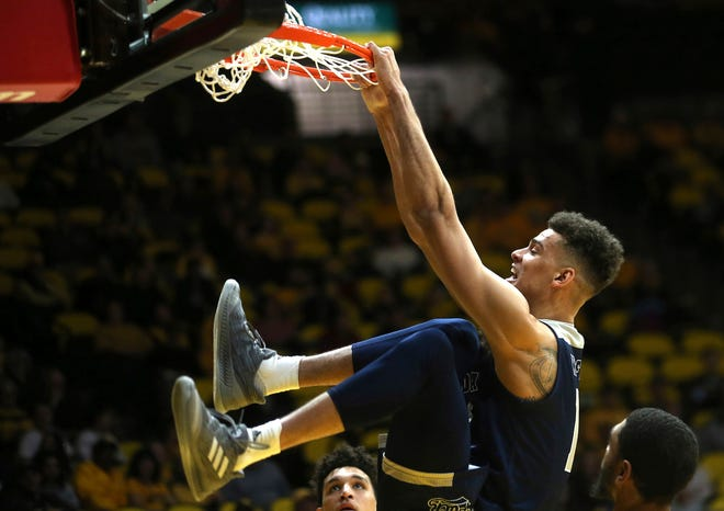 Nevada forward Trey Porter throws down a dunk during the Wolf Pack's big win at Wyoming.