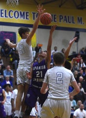 Reed's Kellen George (11) blocks the shot of Spanish Springs' Leo Grass during their basketball game in Sparks on Feb. 16, 2019.