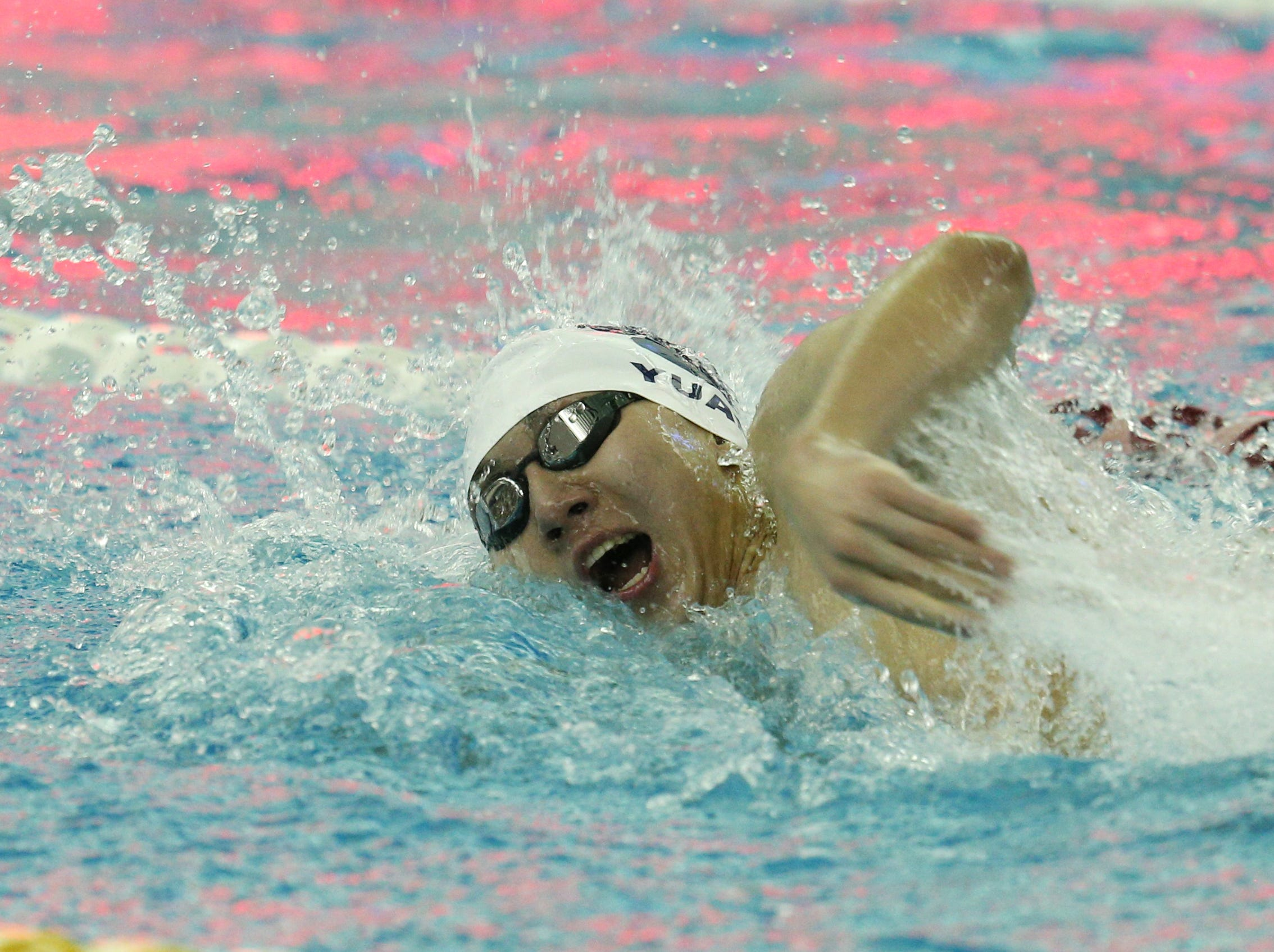 Kyle Yuan swims the third leg for Pittsford en route to victory in the 400-yard freestyle relay.
