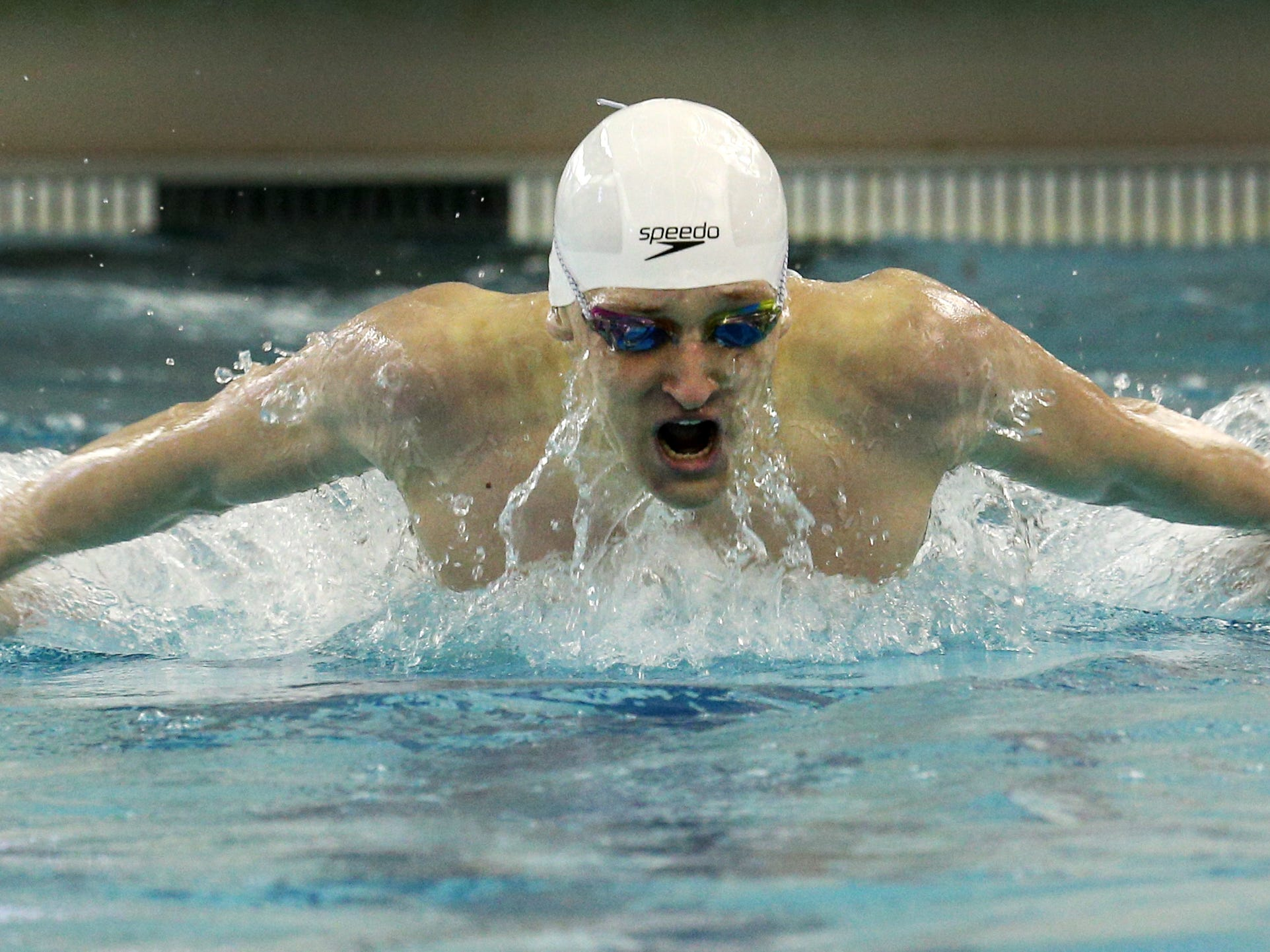 Webster's Adam Sokolowski swims to victory in the 100-yard butterfly.