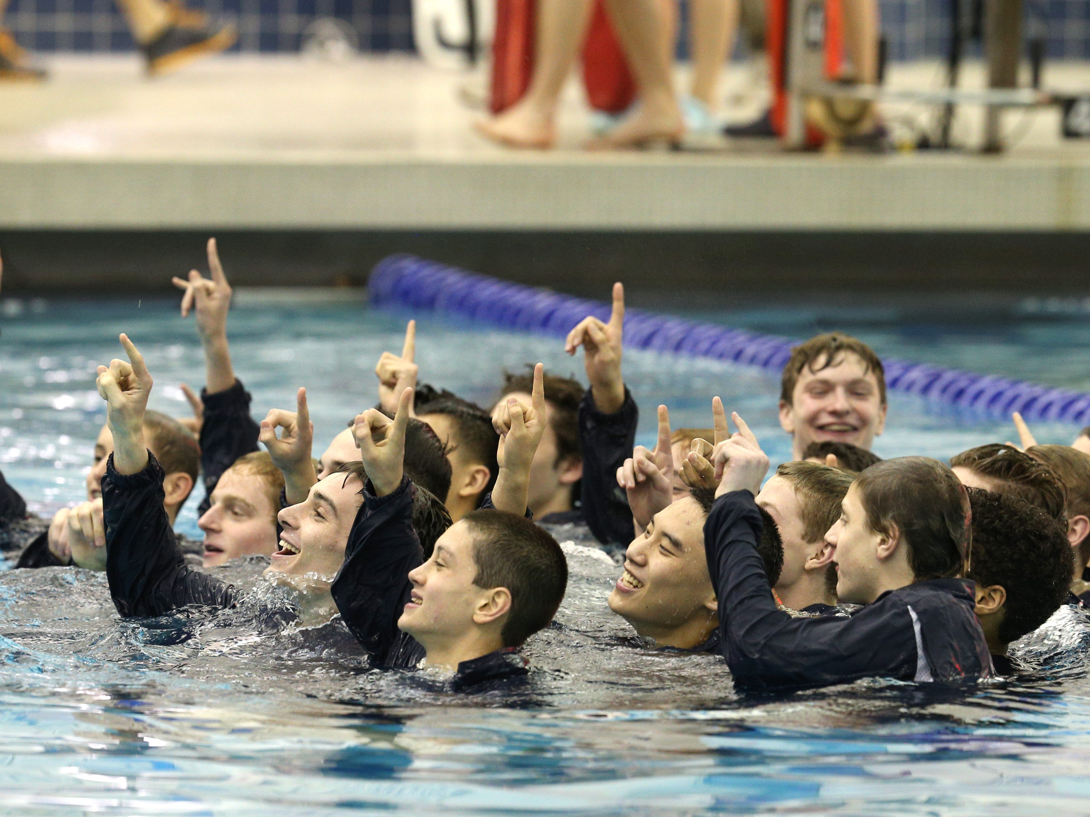 Pittsford celebrates winning its 17th straight Section V Swimming championship.