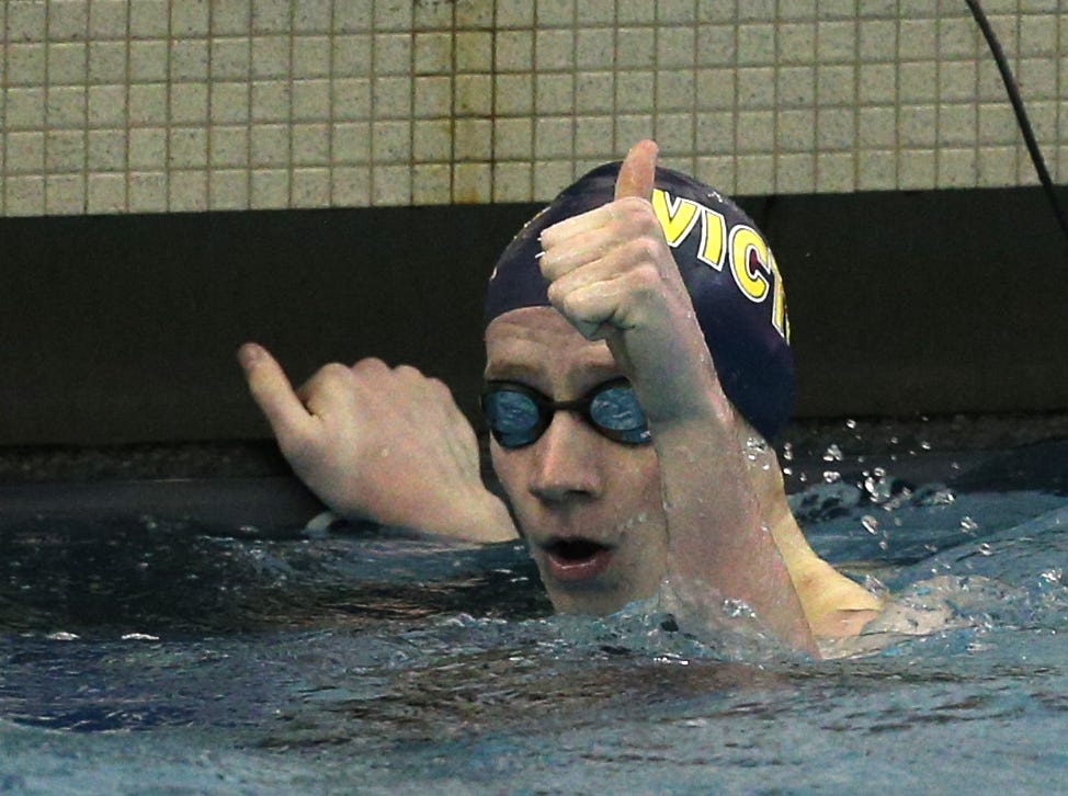 Victor junior Brayden Murphy gives a thumb's up after winning the 200-yard individual medley.