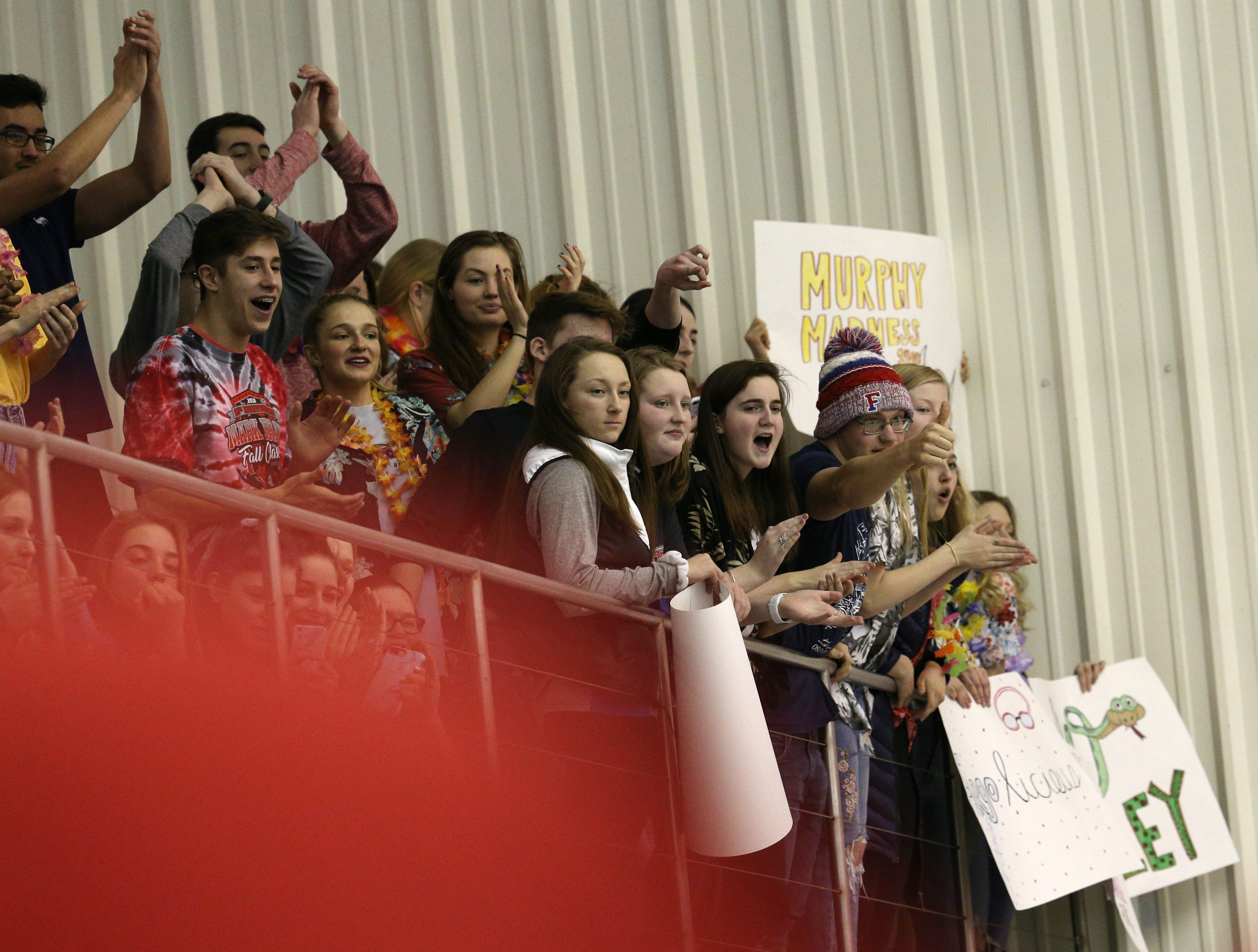 Fans cheer at the Section V Swim Finals.