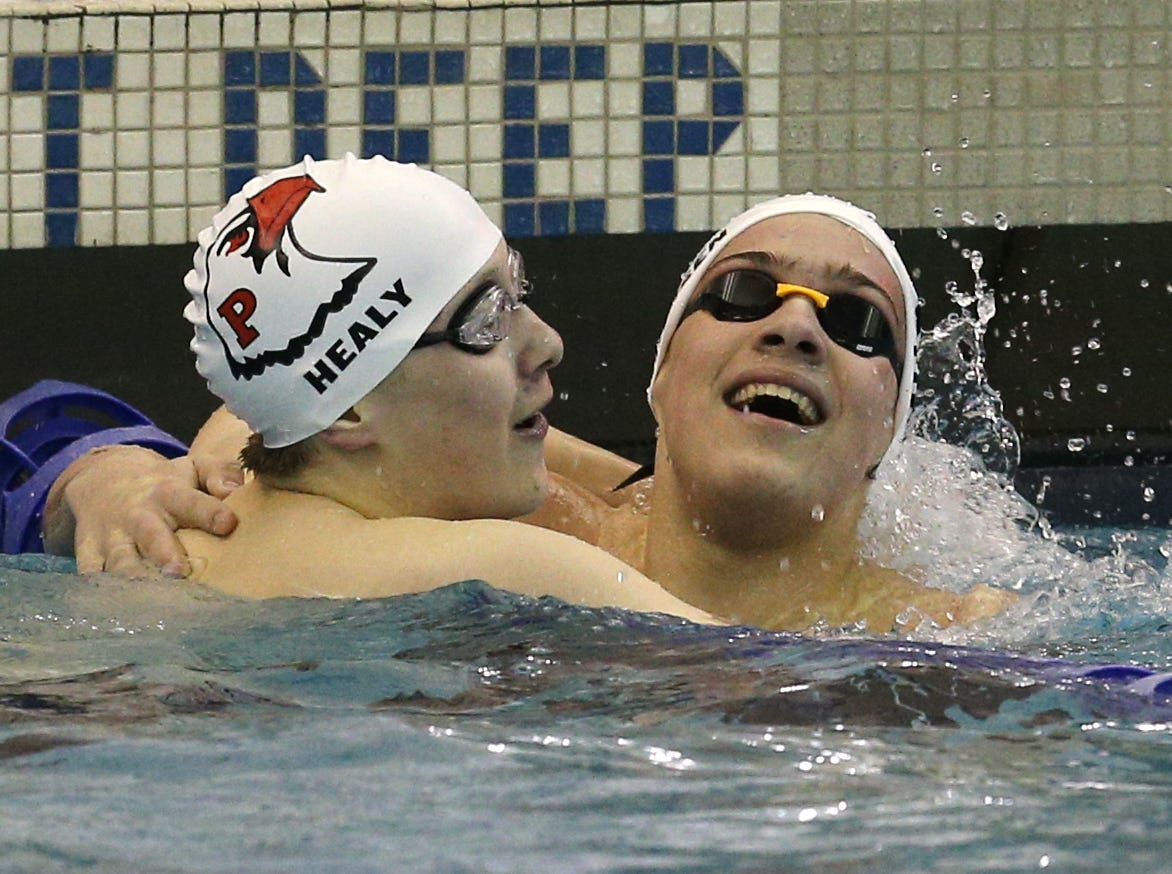 John Healy, left, of  Penfield, celebrates  with teammate Jordan Fixsen after the 200-yard freestyle.