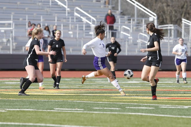 Shasta senior Alexis Highfill (center) winds up to pass the ball during the Division I Northern Section championship on Saturday, Feb. 16, 2019.