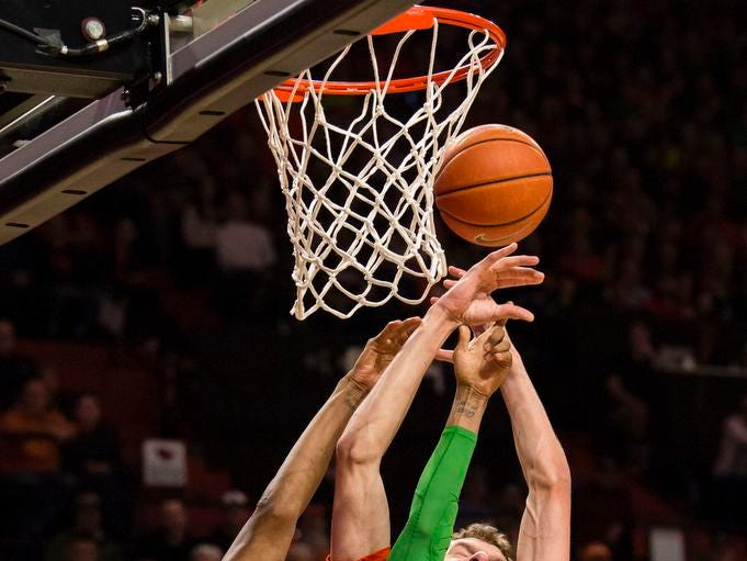 Feb 16, 2019; Corvallis, OR, USA; Oregon Ducks forward Louis King (2) and Oregon State Beavers forward Kylor Kelley (24) struggle to control a rebound during the second half at Gill Coliseum. The Beavers beat the Ducks 72-57. Mandatory Credit: Troy Wayrynen-USA TODAY Sports