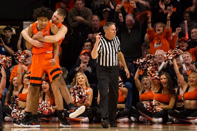 Feb 16, 2019; Corvallis, OR, USA; Oregon State Beavers forward Tres Tinkle (3) embraces guard Ethan Thompson (5) after being fouled and scoring a three point basket during the second half against the Oregon Ducks at Gill Coliseum. The Beavers beat the Ducks 72-57. Mandatory Credit: Troy Wayrynen-USA TODAY Sports