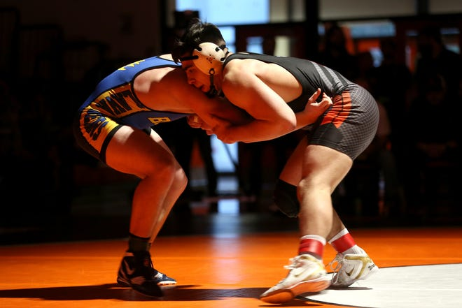 Sprague's Santos Cantu and Bend's Nathan Denney compete for the first place spot in the 182 pound weight class during the Mountain Valley Conference district wrestling tournament championships at Sprague High School in Salem on Saturday, Feb. 16, 2019.