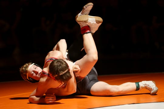 Sprague's Colby Hemmert (back) and Mountain View's Ryder Fassett compete in the 126 pound weight class during the Mountain Valley Conference district wrestling tournament championships at Sprague High School in Salem on Saturday, Feb. 16, 2019.