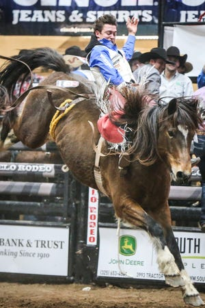 Clayton Biglow rides bareback on Top Notch during Cinch Chute Out Saturday, Feb. 16, 2019, at Foster Communications Coliseum. Biglow was the bareback riding champion.
