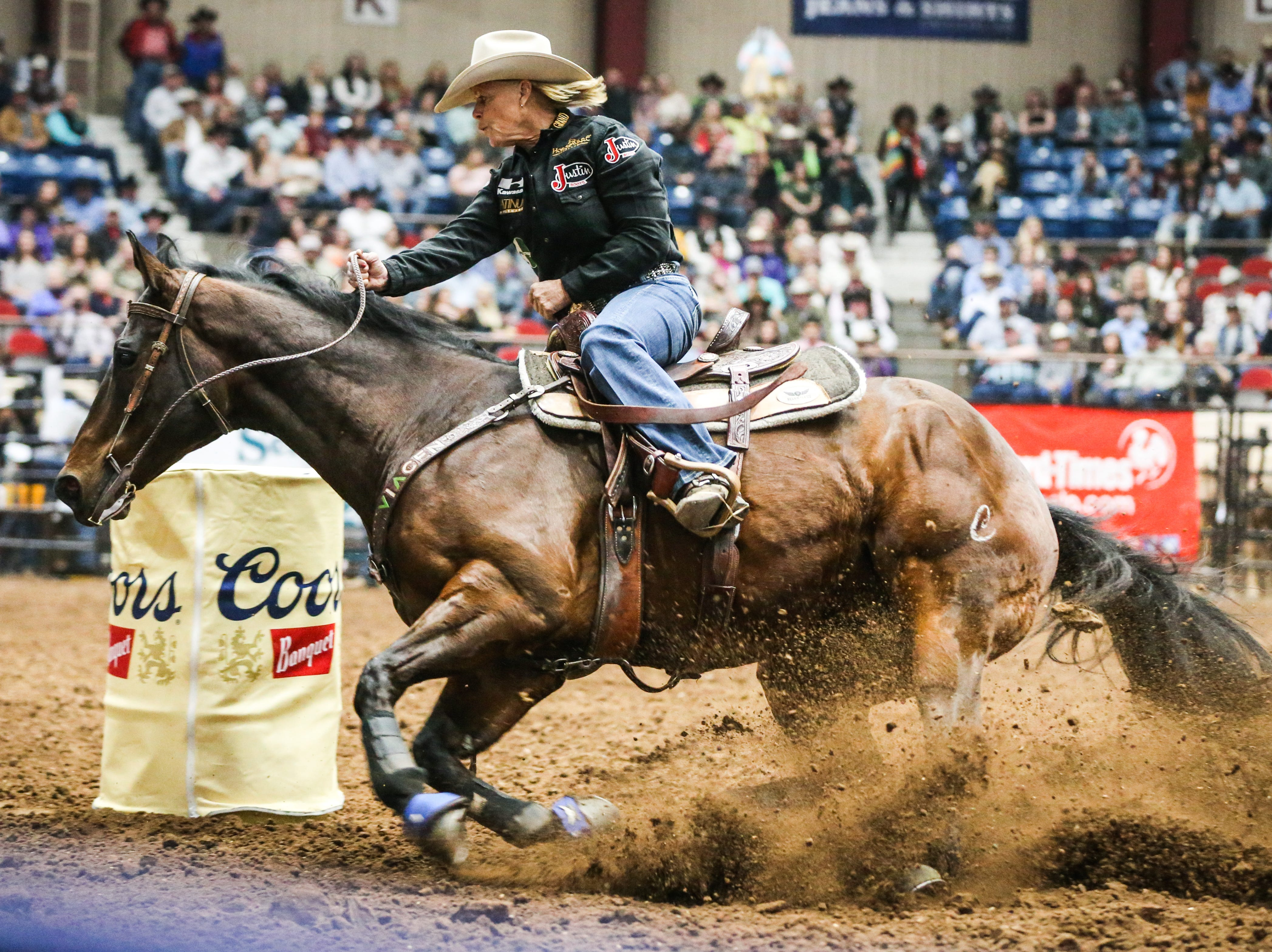 Mary Walker races around the barrels during Cinch Chute Out Saturday, Feb. 16, 2019, at Foster Communications Coliseum.