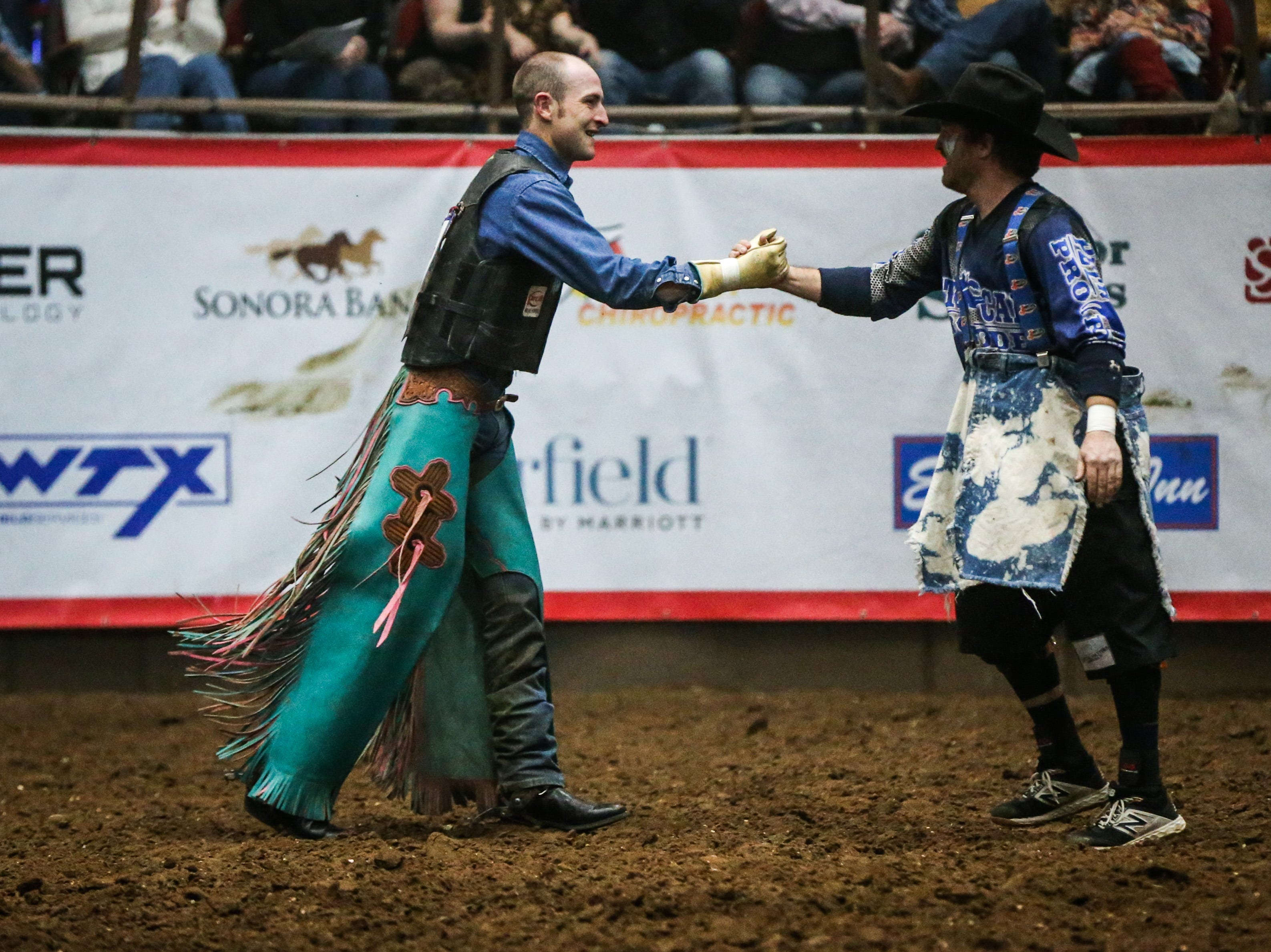 Lon Danley celebrates his 86.5 point ride on Air Marshal during Cinch Chute Out Saturday, Feb. 16, 2019, at Foster Communications Coliseum. Danley was the bull riding champion.