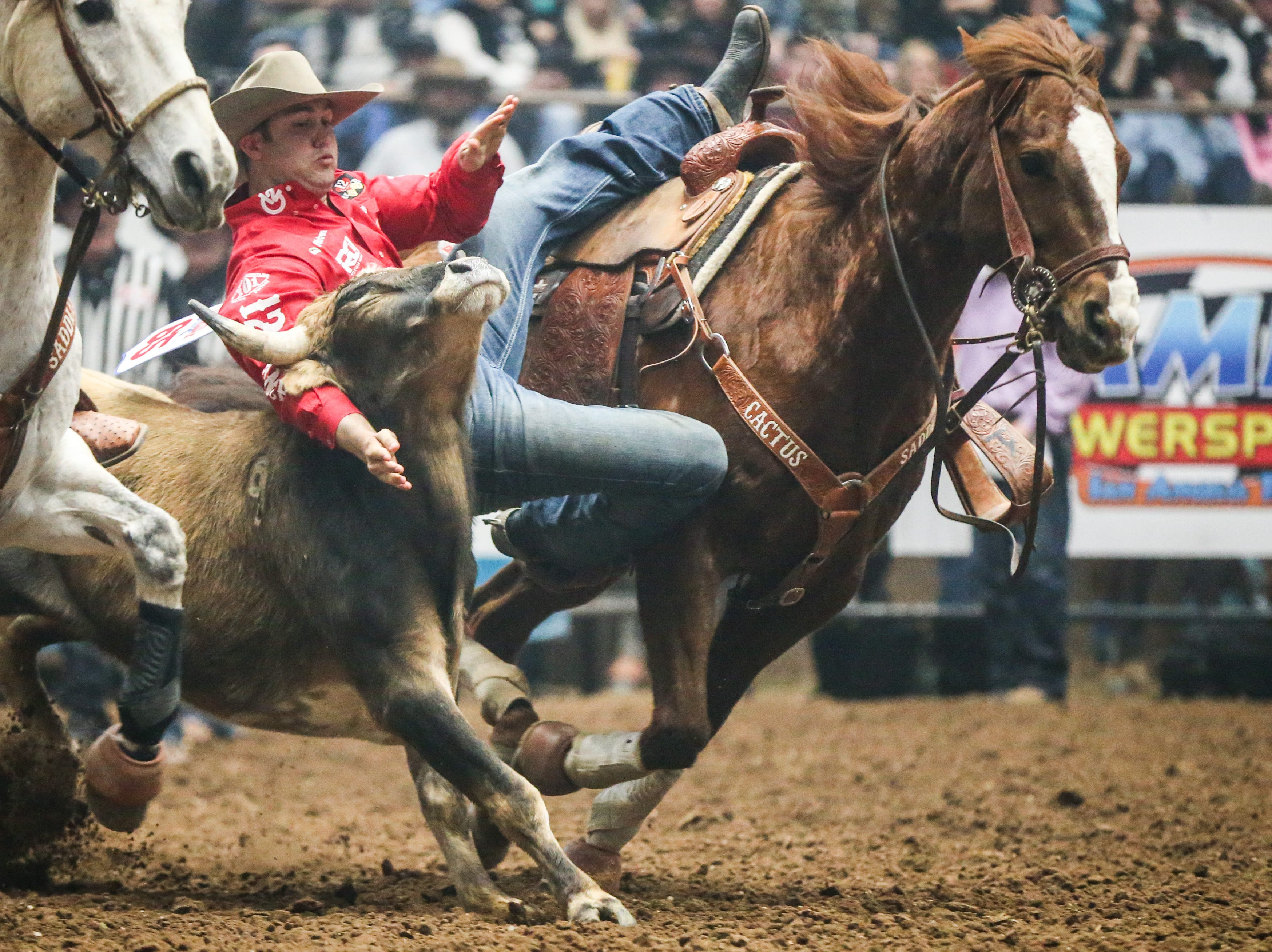 Tyler Waguespack catches a steer to wrestle down during Cinch Chute Out Saturday, Feb. 16, 2019, at Foster Communications Coliseum.