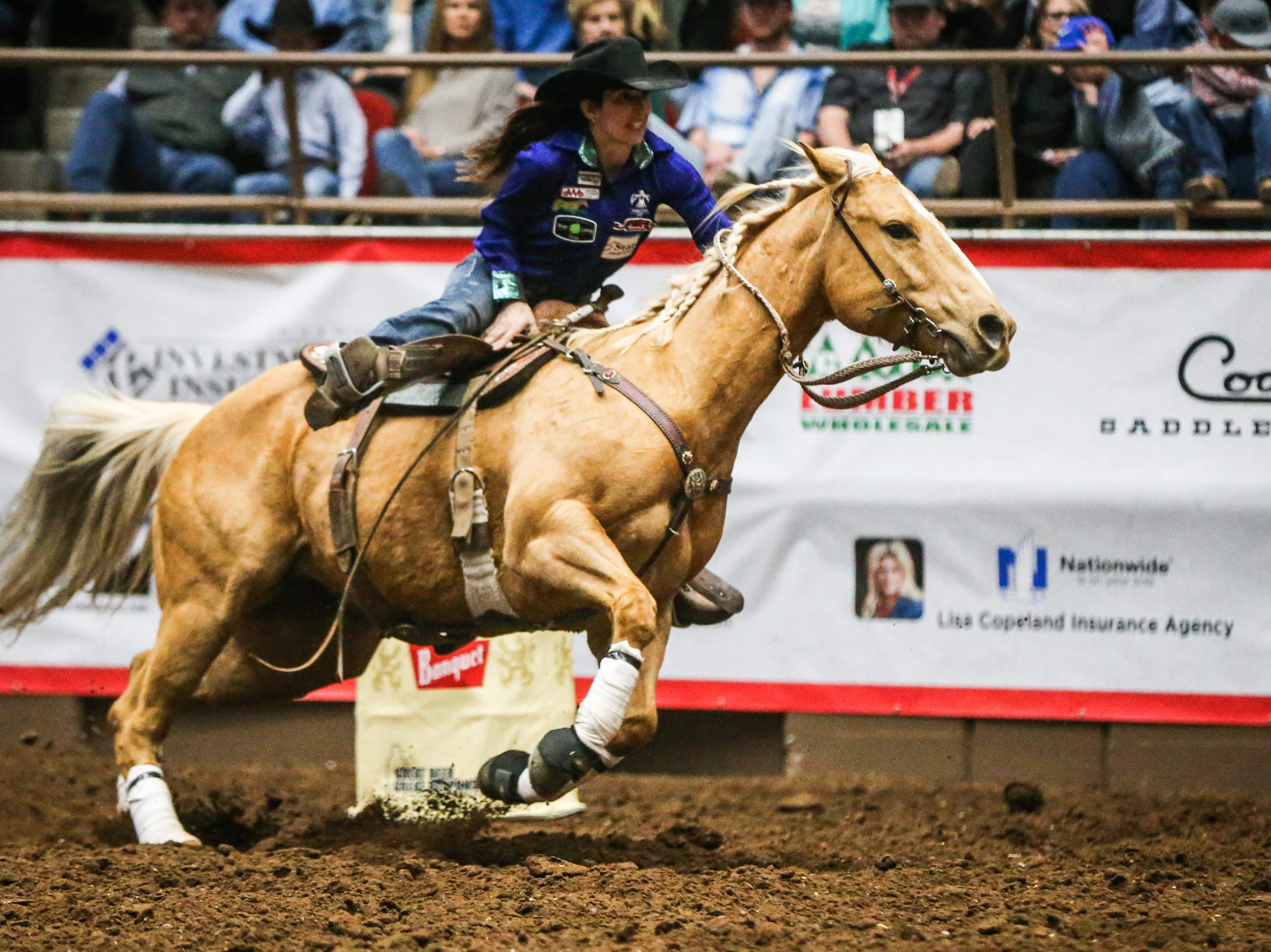 Jessica Routier races around the barrels during Cinch Chute Out Saturday, Feb. 16, 2019, at Foster Communications Coliseum.