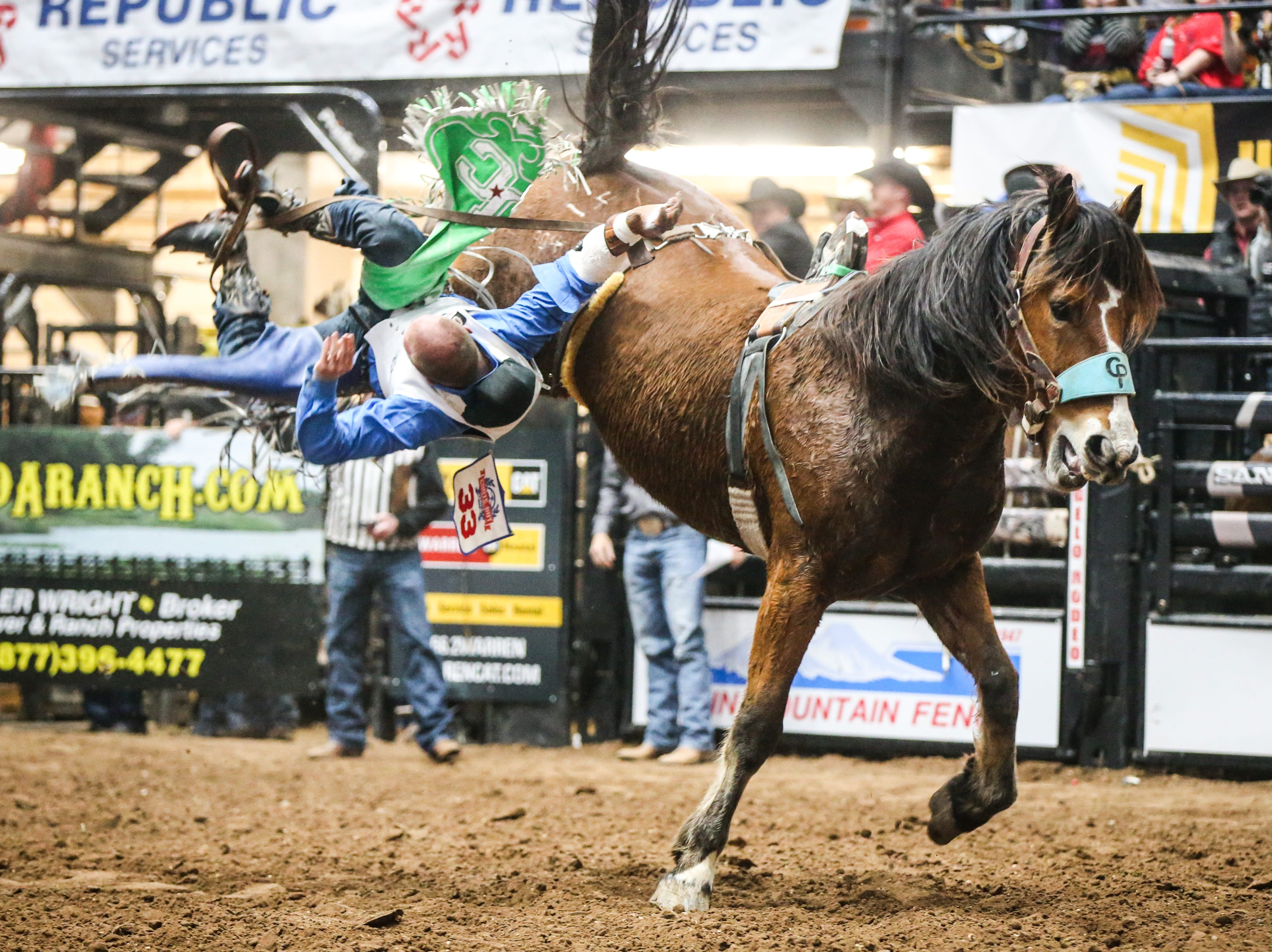 Pascal Isabelle flies off the horse in bareback riding during Cinch Chute Out Saturday, Feb. 16, 2019, at Foster Communications Coliseum.