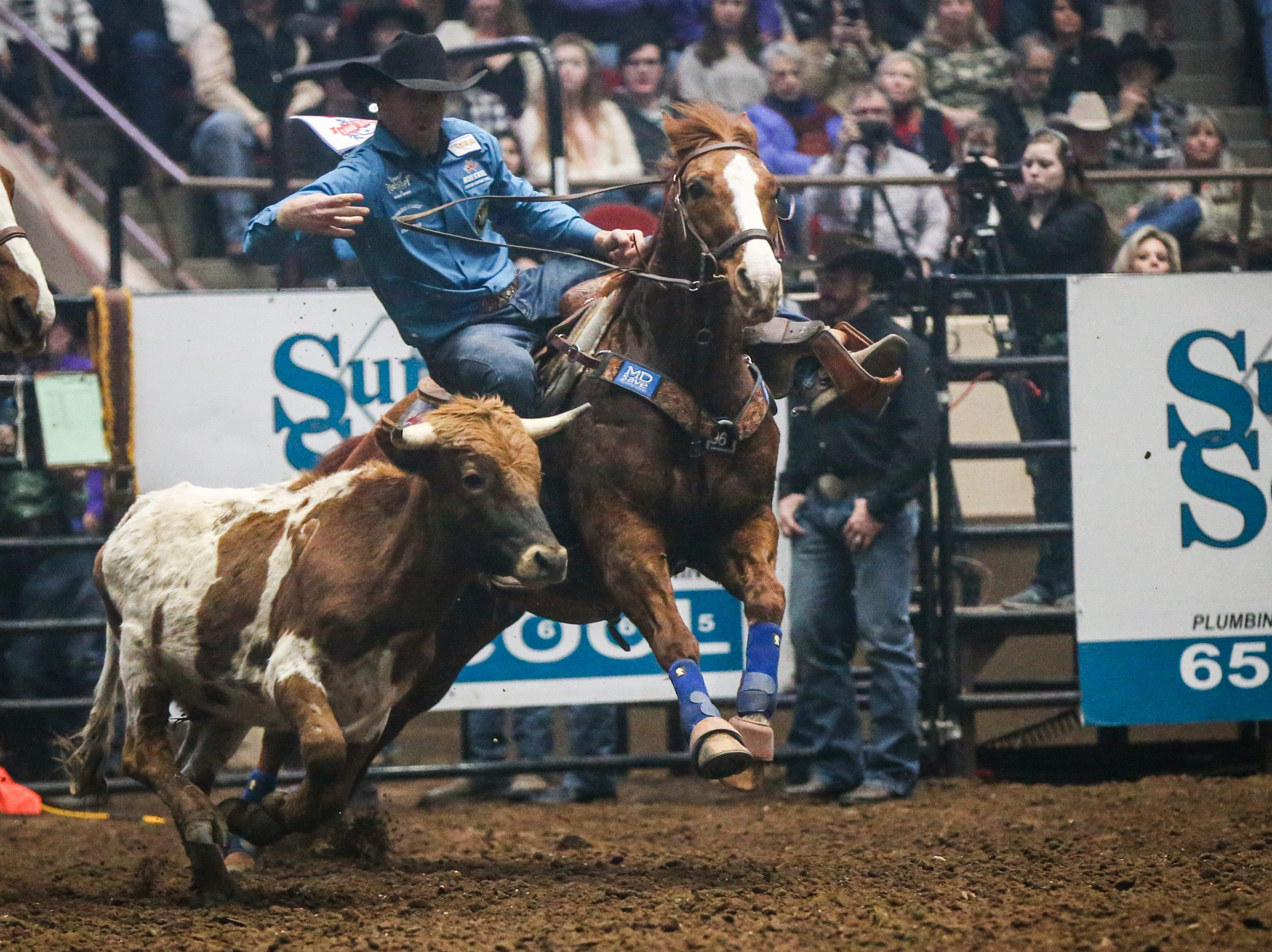 Blake Mindemann rides out to steer wrestle during Cinch Chute Out Saturday, Feb. 16, 2019, at Foster Communications Coliseum. Mindemann was the steer wrestling champion.