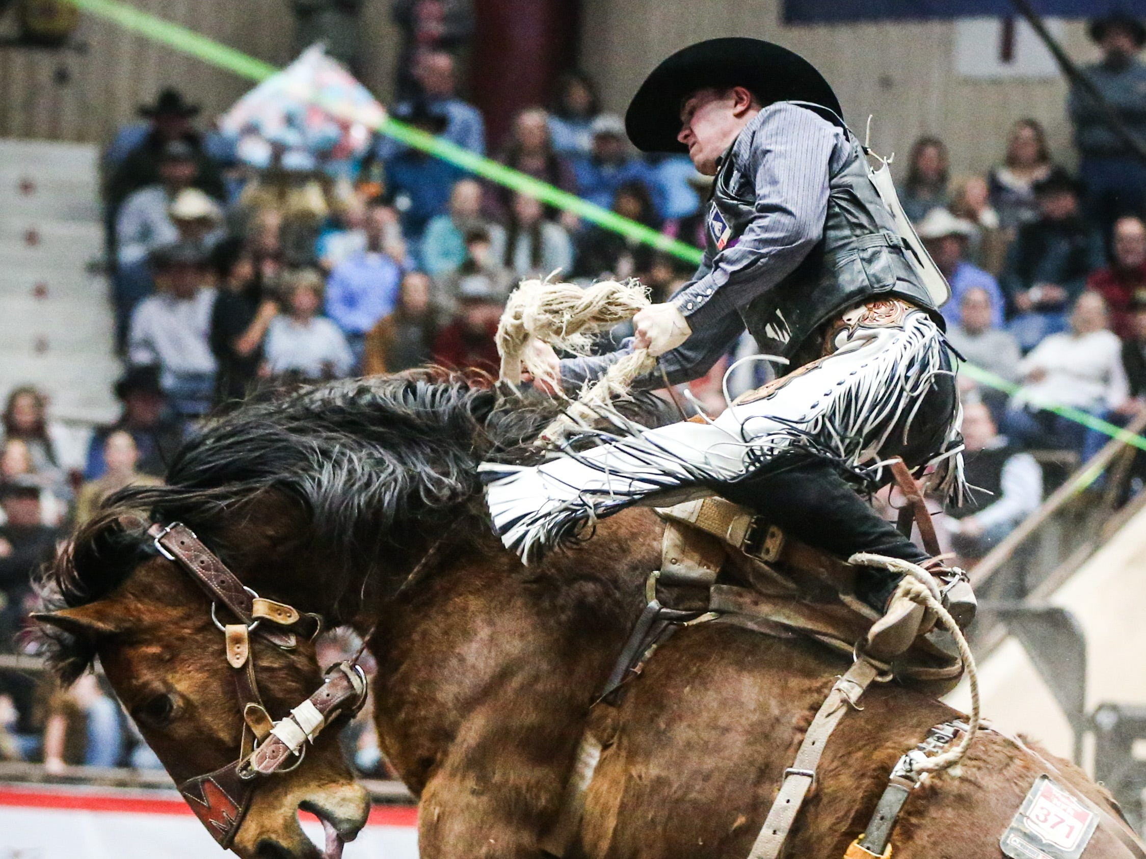 Chase Brooks rides Get Smart during Cinch Chute Out Saturday, Feb. 16, 2019, at Foster Communications Coliseum.
