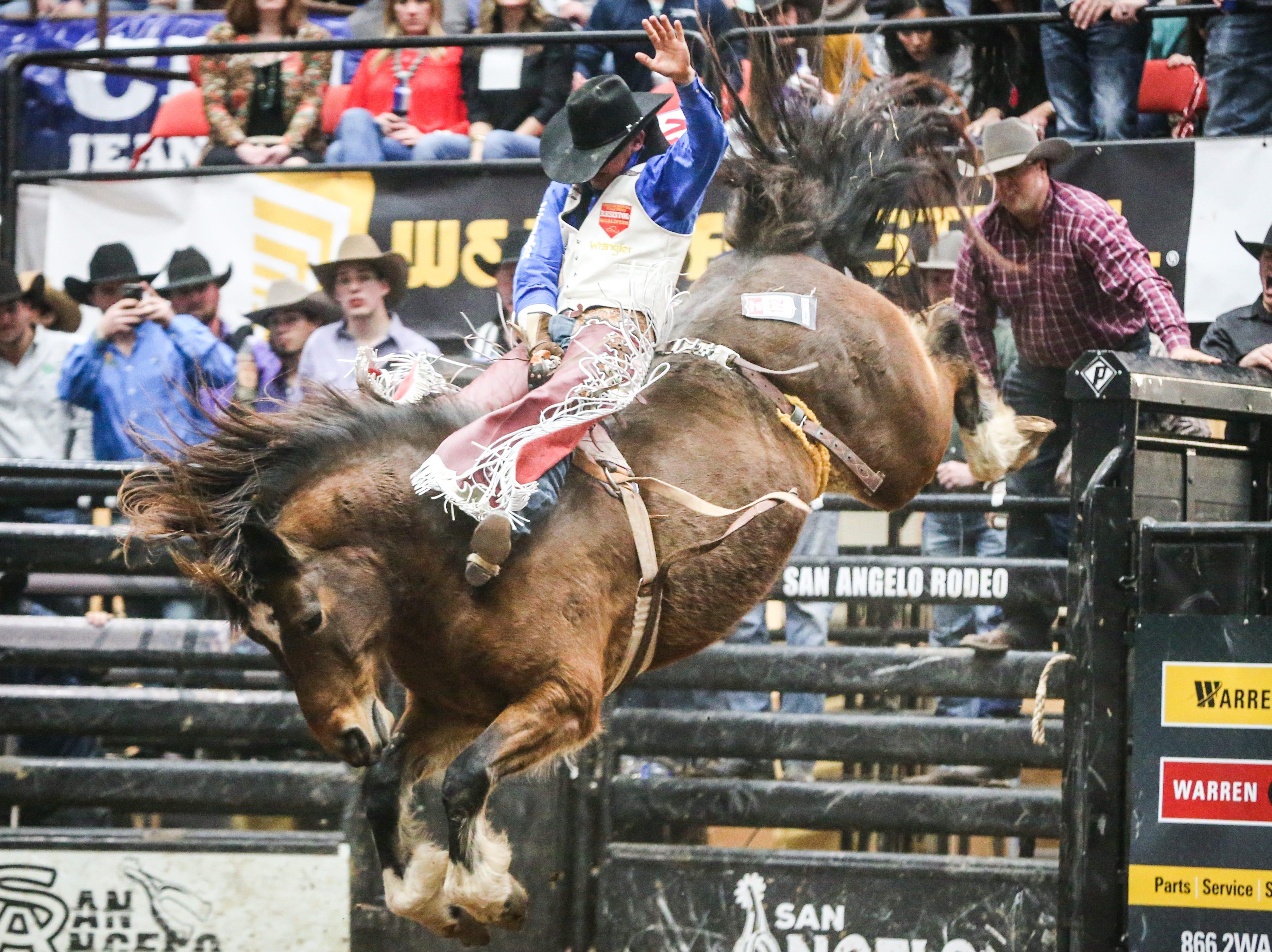Clayton Biglow rides bareback on Top Notch during Cinch Chute Out Saturday, Feb. 16, 2019, at Foster Communications Coliseum. Biglow was the bareback riding champion.
