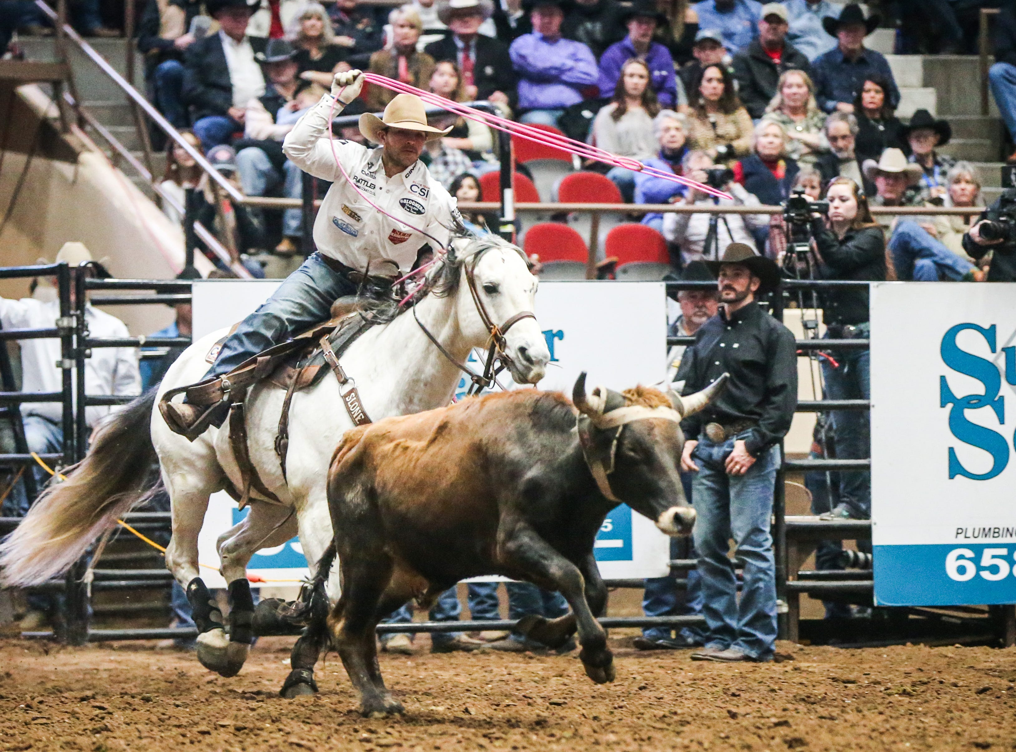 Clay Smith throws his rope during team roping with Paul Eaves during Cinch Chute Out Saturday, Feb. 16, 2019, at Foster Communications Coliseum.