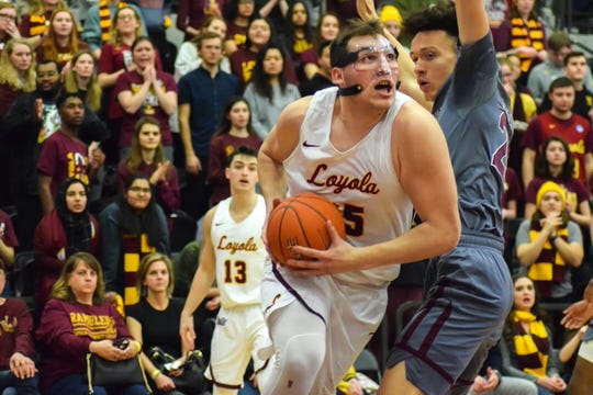 Loyola's Cameron Krutwig makes a move in the post past MSU's Darian Scott.