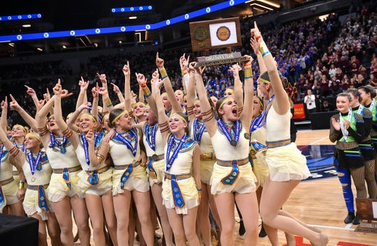 Sartell dancers celebrate with their state championship trophy Saturday, Feb. 16, following the Minnesota Dance Team High Kick finals at the Target Center in Minneapolis.